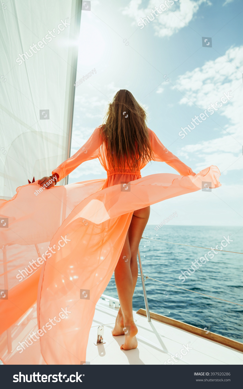 sexy woman in swimwear pareo yacht sea cruise luxury travel vacation with  sunlight and blue sky. Back view